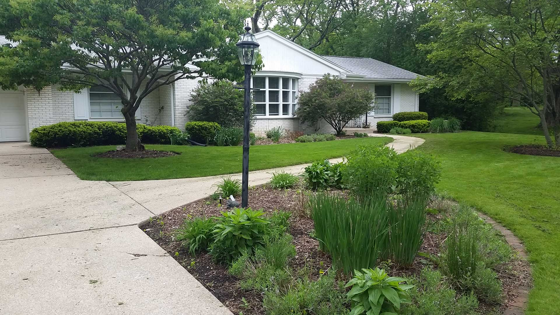 Delafield, WI home with regular landscape maintenance services.
