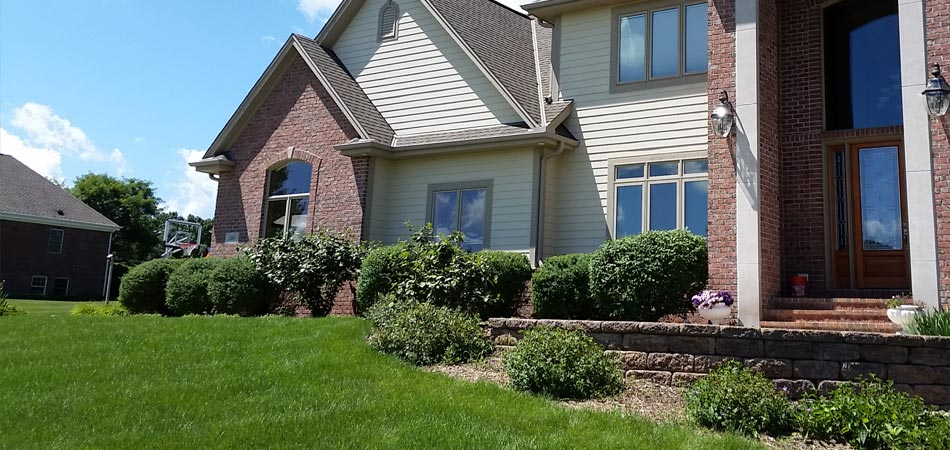 The front lawn of this Brookfield, Elm Grove, WI home is thick and green from the fertilization and weed control services of Beautiful Blooms, LLC.
