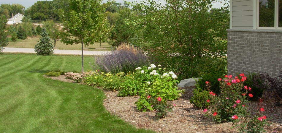 Residential properties in the Pewaukee, WI area can receive the lawn mowing services offered by Beautiful Blooms Landscape & Design, LLC.