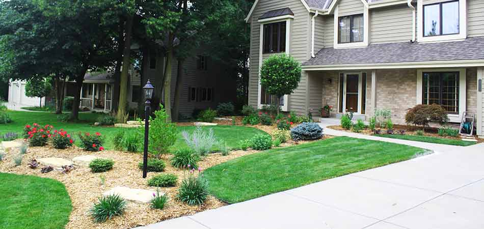 Well pruned plants in the front yard of a customer in Pewaukee, WI.