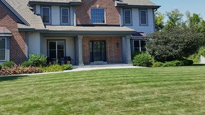 Front yard of a homeowner in Wauwatosa, WI receiving lawn mowing services.